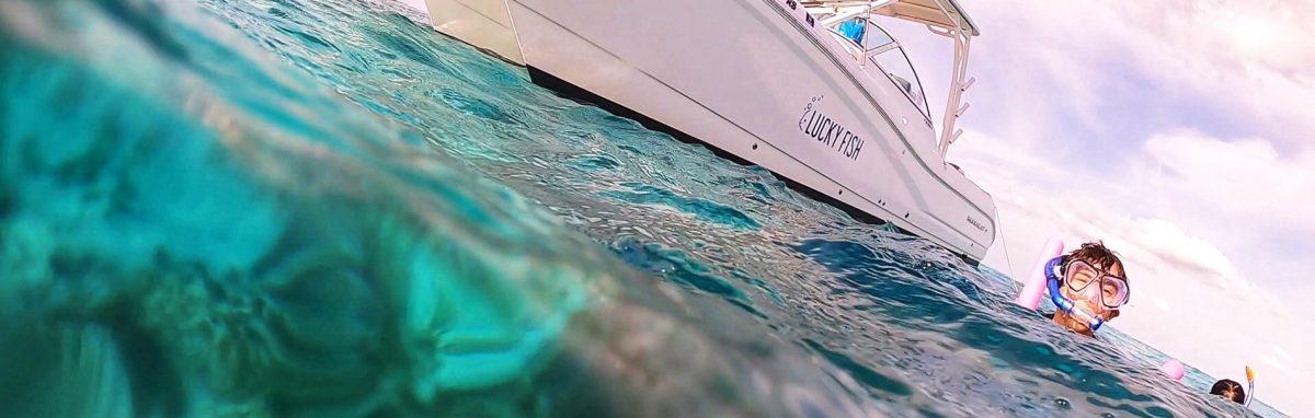 Boy snorkeling next to boat