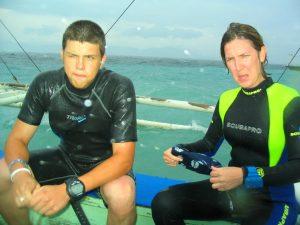 Two wet scuba divers